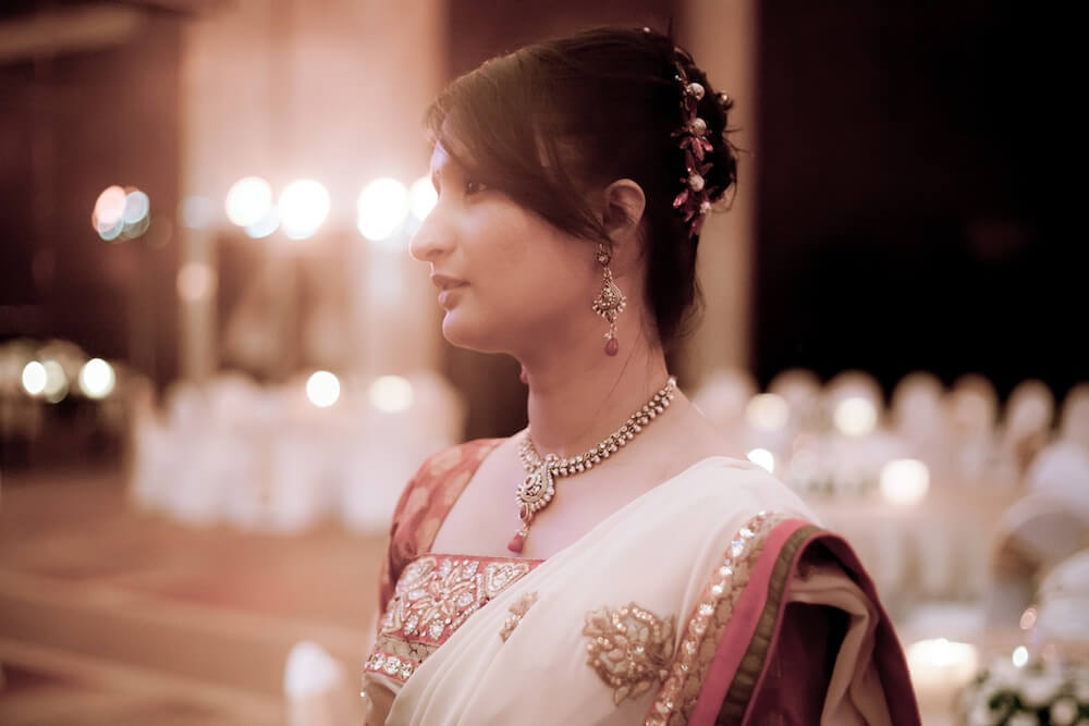 photograph of a lady guest standing during a wedding