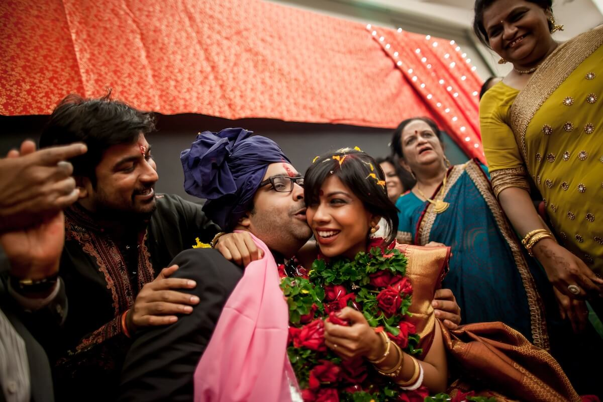 indian couple kissing indian wedding best candid wedding photography